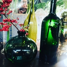 Three green bottles sitting on the wall!