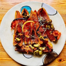 Baked butternut with roasted blood orange and hanepoot grapes. Nothing like ringing the changes with what's in season